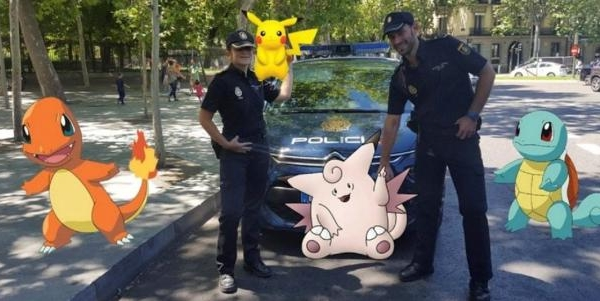 """Spanish police pose with """"Pokemon Go""""  figures in this handout picture provided by the Spanish Interior Ministry on July 18, 2016. Spanish Interior Ministry/Handout via REUTERS"""