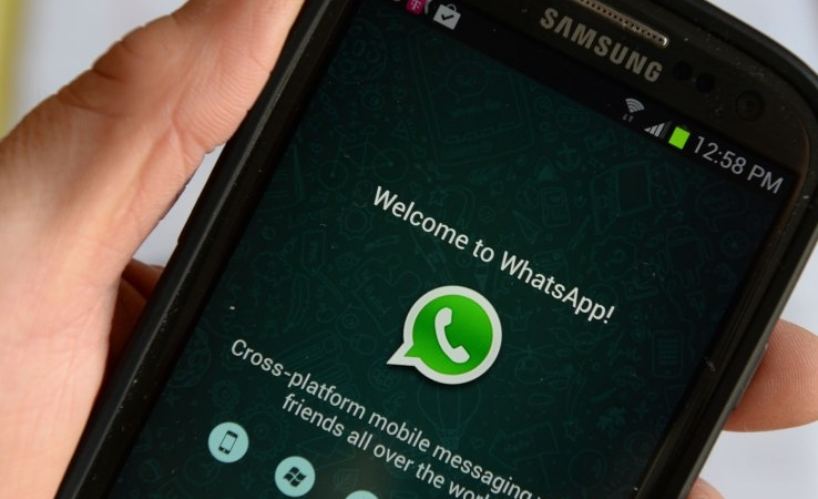 Logo of WhatsApp, the popular messaging service bought by Facebook for USD $19 billion, seen on a smartphone February 20, 2014 in New York.   Facebook's deal for the red-hot mobile messaging service WhatsApp is a savvy strategic move for the world's biggest social network, even if the price tag is staggeringly high, analysts say. AFP PHOTO/Stan HONDA        (Photo credit should read STAN HONDA/AFP/Getty Images)